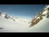raw helmet cam footage: Skier falls off huge rocky cliff and SURVIVES