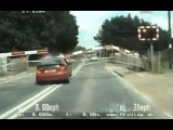 Amazing high-speed police chase as car smashes through level crossing barrier