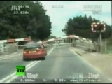 Police chase video: Thief smashes car through rail crossing