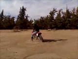 Honda dirtbike throws Sarah while doing donuts.