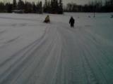 Hillbillies pulling bike behind Snowmachine